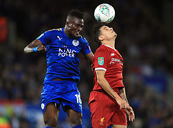 Liverpool's Philippe Coutinho (right) and Leicester City's Daniel Amartey battle for the ball during the Carabao Cup, third round match at the King Power Stadium, Leicester.