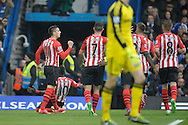 Dusan Tadic of Southampton celebrates with his teammates after scoring his sides first goal of the game from a penalty to make it 1-1. Barclays Premier league match, Chelsea v Southampton at Stamford Bridge in London on Sunday 15th March 2015.<br /> pic by John Patrick Fletcher, Andrew Orchard sports photography.