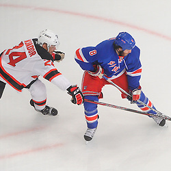 May 14, 2012: New York Rangers right wing Brandon Prust (8) controls the puck away from New Jersey Devils defenseman Bryce Salvador (24) during first period action in game 1 of the NHL Eastern Conference Finals between the New Jersey Devils and New York Rangers at Madison Square Garden in New York, N.Y.