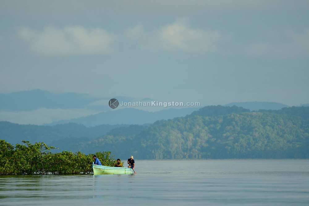 Fisherman ply the waters near some mangroves in the waters of Golfo Dulce, Puntarenas, Costa Rica.