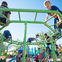 Rehoboth Christian School elementary students play on a tarantula climber at recess following the dedication of their new playground Tuesday morning. The playground was paid for by fundraising through the color runs and donations.