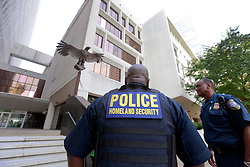 09 July 2014. New Orleans, Louisiana. <br /> Police. Homeland Security outside Federal Court for Ray Nagin trial. Former mayor of New Orleans is sentenced to serve 10 years in prison for bribery and money laundering. <br /> Photo; Charlie Varley/varleypix.com