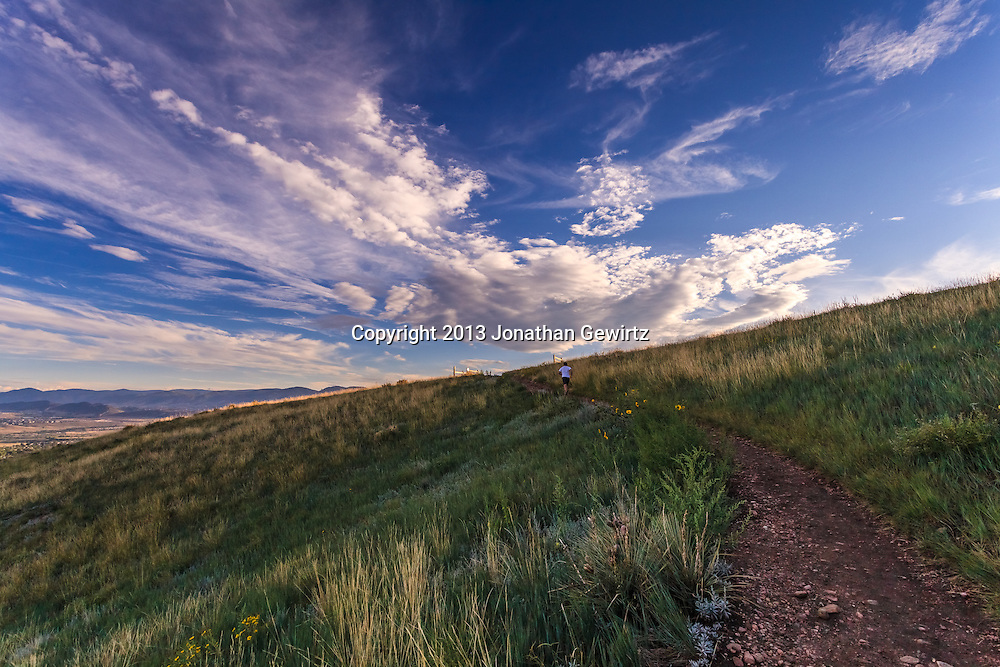 Trail running under big sky in the hills of the William F. Hayden Green Mountain Park in Lakewood, Colorado.<br /> <br /> WATERMARKS WILL NOT APPEAR ON PRINTS OR LICENSED IMAGES.