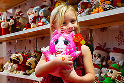 YouTube toy reviewer Paige XOXO, 5, cuddles a soft toy the Toy Fair at Kensington Olympia in London, the UK's largest dedicated game and hobby exhibition featuring the hottest and most anticipated products for the year ahead. London, January 22 2019.