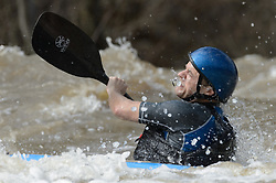 Pete Larson of Ballwin, Mo. practices on the slalom course prior to the start of the 45th Annual Missouri Whitewater Championships. Larson later placed first in the K1 Men's Expert class and fifth in the K1 Men's Long Plastic (30 and up) class. The Missouri Whitewater Championships, held on the St. Francis River at the Millstream Gardens Conservation Area, is the oldest regional whitewater slalom race in the United States. Heavy rain in the days prior to the competition sent water levels on the St. Francis River to some of the highest heights that the race has ever been run. Only expert classes were run on the flood level race course.