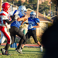 Warriors freshman Skylar Milford (7), leaps in front of Pine Hill receiver Garden Martinez (38) for the interception, in Navajo on Saturday.