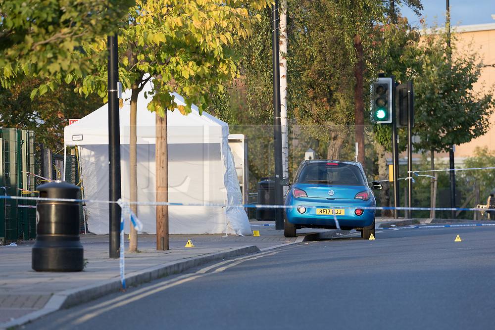 © Licensed to London News Pictures. 13/10/2018. London, UK.  Forensic markers seen in the road at the crime scene at Manford Way in Hainault, where police were called at approximately 10:20pm last night to reports of two men stabbed in Manford Way, Hainault and one man, believed aged 23, was pronounced dead at the scene. The second man, believed aged 22, was taken to an east London hospital for treatment where he remains in a critical condition..  Photo credit: Vickie Flores/LNP