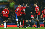 Paul Pogba of Manchester United (c) discusses a foul with Referee Andre Marriner. Premier league match, Everton v Manchester Utd at Goodison Park in Liverpool, Merseyside on New Years Day, Monday 1st January 2018.<br /> pic by Chris Stading, Andrew Orchard sports photography.