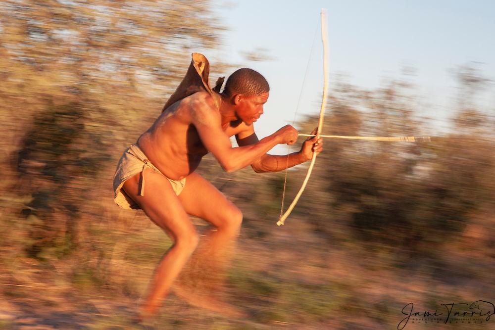 A motion-blur of a San bushmen of the Kalahari with his bow and poison arrow, Kalahari, Botswana, Africa
