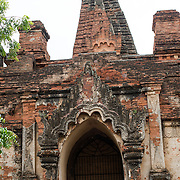 Remnants of the ornate stucco exterior of Gu-byauk-gyi Temple in Nyaung-U, Myanmar (Burma).
