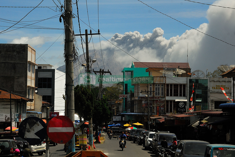 June 15, 2018 - north sumatera, Indonesia - The clear, blue sky was quickly turned grey with ash. In this shot, you can see the flows of dust and smoked sulfatara generated by the eruption. Seen fro kabanjahe city. Even with the relative size of the eruption, there is no chance this causes any climate impact. The initial estimates of sulfur released are too low to cause much atmosphere effects and the height of eruption wasn't tall enough to reach the stratosphere. (Credit Image: © Sabirin Manurung/Pacific Press via ZUMA Wire)
