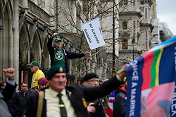 © Licensed to London News Pictures. 21/12/2016. London, UK. Former Royal Marines gather outside the Royal Courts of Justice in London to show support for Royal Marine Sergeant Alexander Blackman at his bail hearing. Sgt Blackman is currently serving a life sentence after being convicted of murdering a wounded Taliban fighter in Afghanistan in 2011. Photo credit: Ben Cawthra/LNP