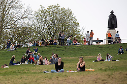 © Licensed to London News Pictures. 31/03/2021. London, UK. Members of the public relax and enjoy the warm weather in Greenwich Park in South East London. Temperatures are expected to rise with highs of 22 degrees forecasted for parts of London and South East England today . Photo credit: George Cracknell Wright/LNP