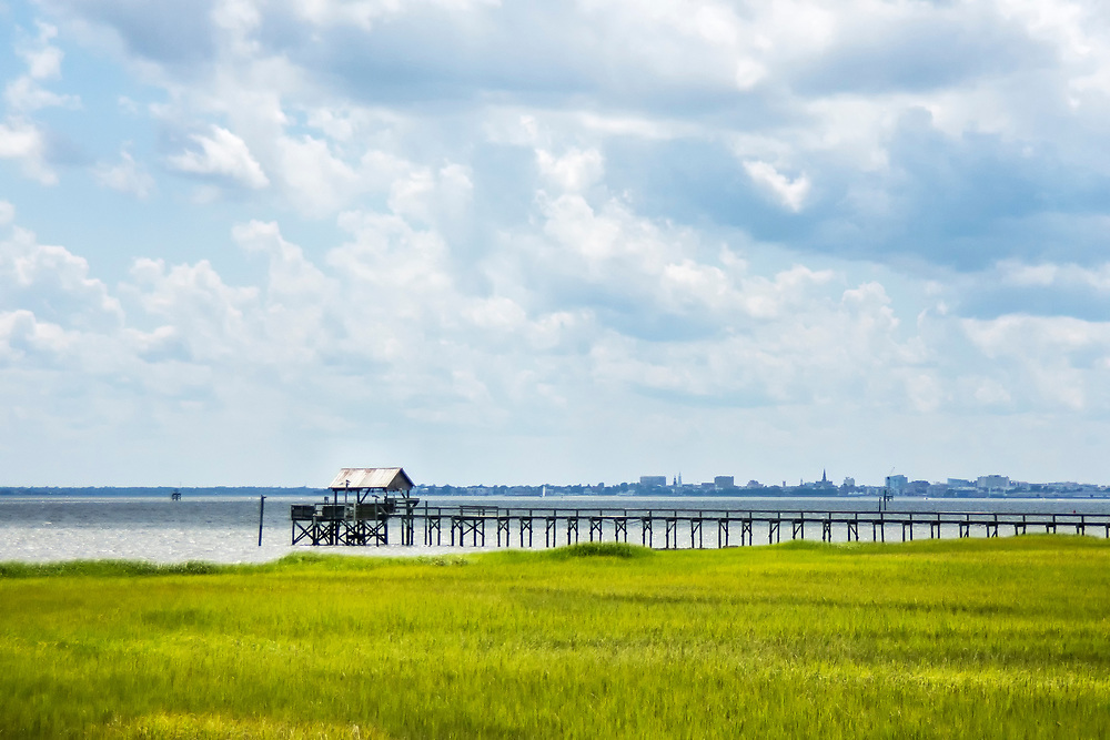A boat dock stretches across the marsh at Pitt Street Bridge, a local park on a former highway bridge, in Mount Pleasant, South Carolina on Wednesday, June 24, 2020. Copyright 2020 Jason Barnette