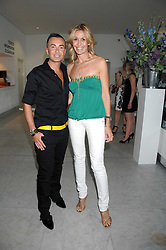 JULIEN MACDONALD and MELISSA ODABASH at a reception hosted by Vogue magazine to launch photographer Tim Walker's book 'Pictures' sponsored by Nude, held at The Design Museum, Shad Thames, London SE1 on 8th May 2008.<br />
