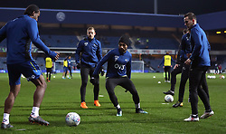 Derby County's Ikechi Anya (centre) warms up before the Sky Bet Championship match at Loftus Road, London.