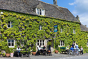 Traditional Cotswold ivy-clad pub in the picturesque village of Southrop in the Cotswolds, Gloucestershire, UK