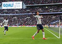 Football - 2017 / 2018 Premier League - Tottenham Hotspur vs. Liverpool<br /> <br /> Dele Alli (Tottenham FC)  celebrates scoring his sides third goal on the stroke of half time at Wembley Stadium.<br /> <br /> COLORSPORT/DANIEL BEARHAM