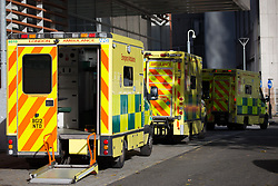 © Licensed to London News Pictures. 21/10/2021. London, UK. Ambulances are seen lined up outside The Royal London Hospital in east London. Health Secretary Sajid Javid warned Covid 19 cases could reach 100,000 a day this winter and urged people to take precautions against the virus. Photo credit: Marcin Nowak/LNP
