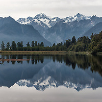 Lake Matheson with Mount Tasman (3497m) and New Zealand's highest mountain, Mount Cook (3754m), in the background.