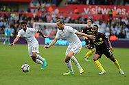 Gylfi Sigurdsson of Swansea city (c) in action. Premier league match, Swansea city v Manchester city at the Liberty Stadium in Swansea, South Wales on Saturday 24th September 2016.<br /> pic by Andrew Orchard, Andrew Orchard sports photography.