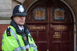 © licensed to London News Pictures. London, UK 13/12/2012. A police officer guardian the entrance to Westminster Coroner's Court. The inquest into the death of Jacintha Saldanha, the nurse who apparently took her own life after being duped by two Australian DJ hoax callers, has been opened at Westminster Coroner's Court on 13/12/12 in London. Photo credit: Tolga Akmen/LNP