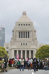 April 14, 2018 - Tokyo, Japan - Anti-Abe protesters gather in front the National Diet Building claiming PM Shinzo Abe's resignation in Tokyo, Japan. Organizers claim about 30,000 protesters joined the rally demanding Abe's resignation for the Moritomo Gakuen and Kake Gakuen scandals. (Credit Image: © Rodrigo Reyes Marin/via ZUMA Wire via ZUMA Wire)