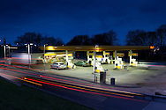 South Queensferry Shell Petrol Station. Scotland. Light trails and cars filling up with fuel.