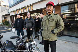 Go Takamine (red hat) with Harley-Davidson's design team members (L>R) Dais Nagao, team leader Ray Drea, Charlie Wartgow and Ben McGinley during their visit to Go's Brat Style shop. Tokyo, Japan. Monday, December 8, 2014. Photograph ©2014 Michael Lichter.