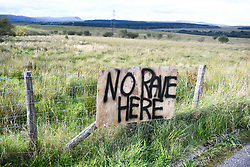 © Licensed to London News Pictures. 30/08/2020. City, UK. A sign saying 'No Rave Here' in the village of Banwen in South Wales, during an illegal rave. The event, which was held in forestry above the village was attended by an estimated 3000 people from all over the UK. The government recently strengthened the laws to fine organisers of the illegal parties £10,000. Photo credit: Robert Melen/LNP