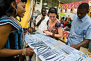 Customers look a jewelry while a vendor welcomes them at her booth at the 22nd Salon International de l'Artisanat de Ouagadougou (SIAO) in Ouagadougou, Burkina Faso on Friday October 31, 2008.
