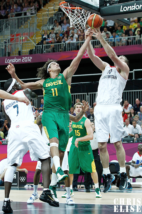 31 July 2012: Brazil Anderson Varejao vies for the rebound with .Robert Archibald during 67-62 Team Brazil victory over Team Great Britain, during the men's basketball preliminary, at the Basketball Arena, in London, Great Britain.