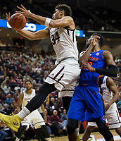 Texas A&M center Tyler Davis (34) pulls down a rebound against Florida forward Kevarrius Hayes (13) during the second half of an NCAA college basketball game Tuesday, Jan. 2, 2018, in College Station, Texas. (AP Photo/Sam Craft)