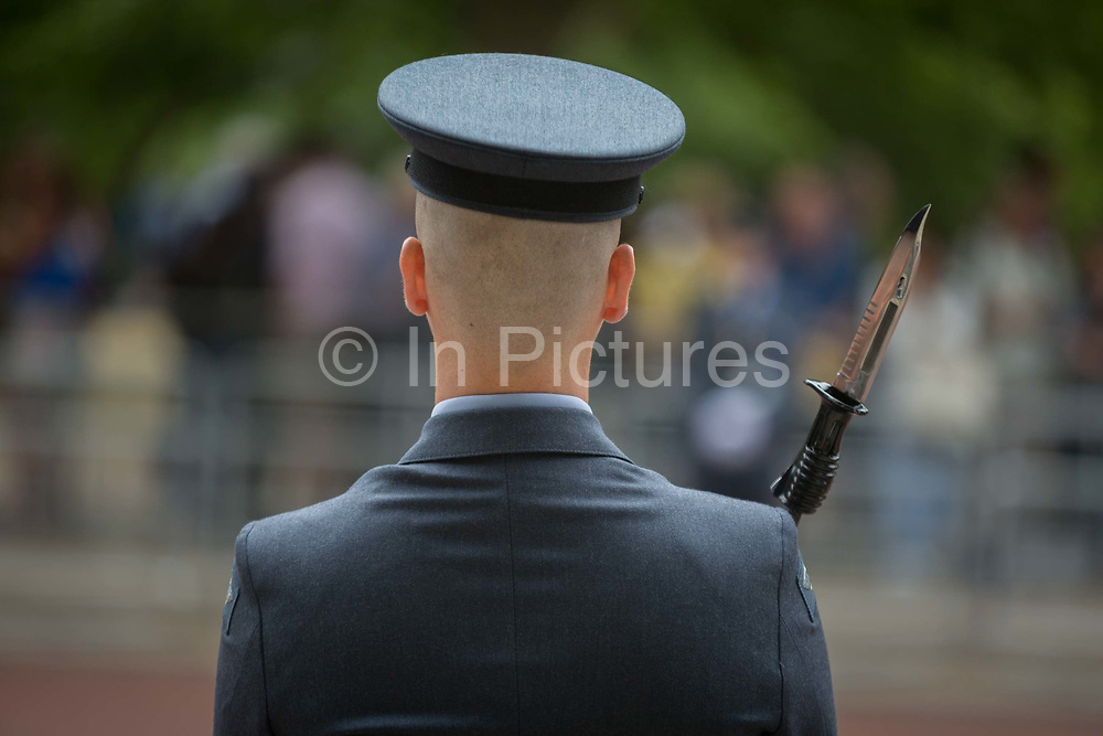 On the 100th anniversary of the Royal Air Force RAF and before an historic flypast of 100 aircraft formations representing Britains air defence history which flew over central London, a guard of the RAF regiment lines the Mall, on 10th July 2018, in London, England.