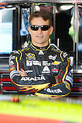 Jeff Gordon stands in the garage area before a practice run for a NASCAR Sprint Cup series auto race, Friday, May 9, 2014, at Kansas Speedway in Kansas City, Kan. (AP Photo/Colin E. Braley)