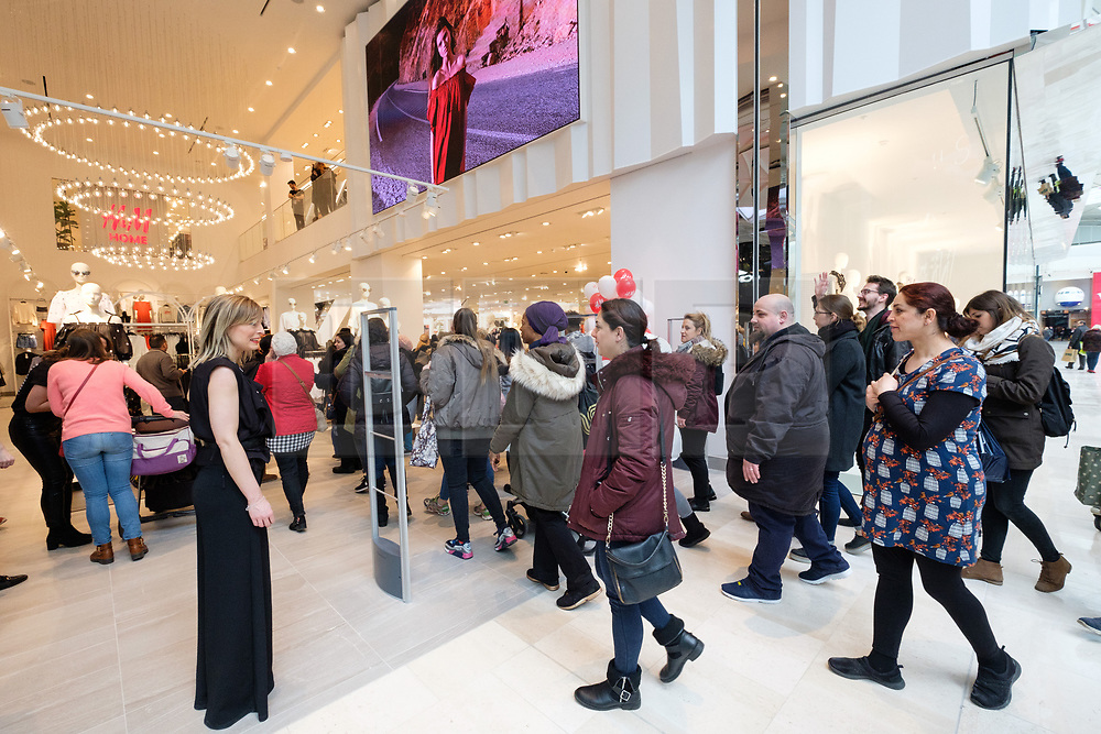 © Licensed to London News Pictures. 20/03/2018. London, UK. Customers enter the new H&M store opening in Westfield London today launching the first phase opening of its £600m expansion, 6-months ahead of schedule. Photo credit: Ray Tang/LNP