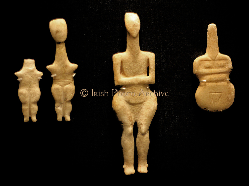 Marble figurine of a woman (Plastiras type) Cycladic (grotta-pelos culture)3000-2800 BC. Said to be from Grave 'D' of the Kapros cemetery, Amorgos. The long neck, angular upper body and bulging thighs are characteristic of this type but the cut out areas separating the upper arms from the body are unusual.