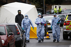 © Licensed to London News Pictures. 11/12/2015. London, UK. Police forensics at the scene of a shooting in North London following an an intelligence led operation. Photo credit: Tolga Akmen/LNP