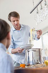 Father hand overing meal to son