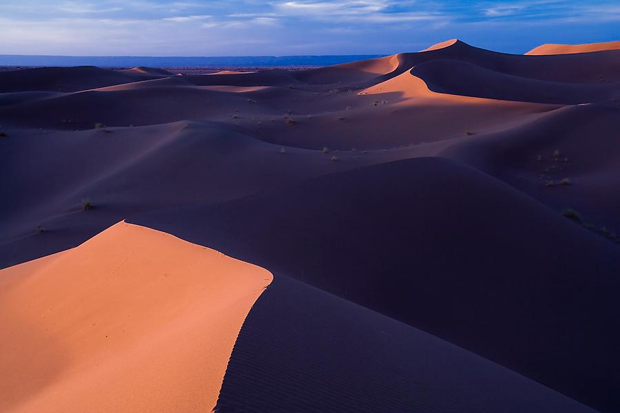 Last light falls on the large sand dunes of Erg Zehar, near M'hamid, Morocco.
