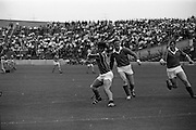 17/08/1969<br /> 08/17/1969<br /> 17 August 1969<br /> All-Ireland Senior Semi-Final: Kilkenny v London at Croke Park, Dublin.<br /> This Kilkenny forward looks determined as he prepares to hit the ball towards the London goalmouth.