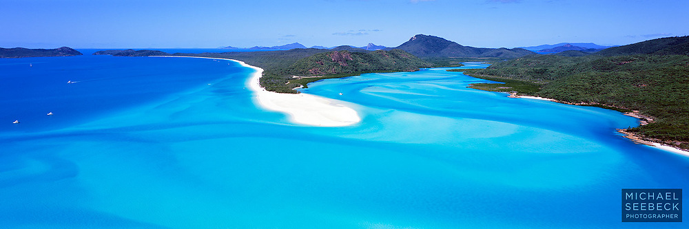 An aerial panoramic photograph of Whitehaven Beach and Cook Inlet on Whitsunday Island.<br /> <br /> Code: HAQW0005<br /> <br /> Limited Edition Print