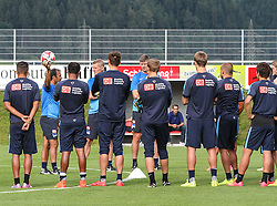 04.08.2014, Athletic Area, Schladming, AUT, Hertha BSC, im Bild Jos Luhukay (Hertha BSC, Trainer) mit einem Ball in der Hand und Spielern // during a training session of the German Bundesliga Club Hertha BSC at the Athletic Area, Austria on 2014/08/04. EXPA Pictures © 2014, PhotoCredit: EXPA/ Martin Huber