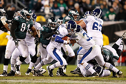 Indianapolis Colts quarterback Peyton Manning #18 is sacked by Philadelphia Eagles linebacker Ernie Sims #50 during the NFL Game between the Indianapolis Colts and the Philadelphia Eagles. The Eagles won 26-24 at Lincoln Financial Field in Philadelphia, Pennsylvania on Sunday November 7th 2010. (Photo By Brian Garfinkel)