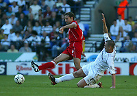 Photo. Andrew Unwin<br /> Bolton Wanderers v Middlesbrough, Barclaycard Premier league, Reebok Stadium, Bolton 13/09/2003.<br /> Bolton's Kevin Nolan (r) can't stop Middlesbrough's Gareth Southgate (l) passing the ball upfield.