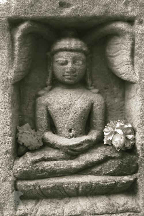 Rock carving detail of a meditating Buddha at Mrigadavam, an ancient temple complex where Gautama Buddha gave his first sermon