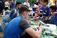 AFC Wimbledon midfielder Anthony Hartigan (26) signing autographs for AFC Wimbledon foundation during the EFL Sky Bet League 1 match between AFC Wimbledon and Oldham Athletic at the Cherry Red Records Stadium, Kingston, England on 21 April 2018. Picture by Matthew Redman.