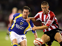 Photo: Paul Greenwood.<br />Sheffield United v Cardiff City. Coca Cola Championship. 02/10/2007.<br />Cardiff's Robbie Fowler (L) battles with Paul Parry