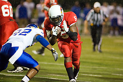 24 September 2011: With rain falling Ashton Leggett  heads up the middle and is challenged by Eric Wood during an NCAA football game between the South Dakota State Jackrabbits (SDSU) and the Illinois State Redbirds (ISU) at Hancock Stadium in Normal Illinois.