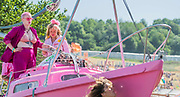 The Extinction Rebellion protest march around the site, led by their Iconic pink boat, Tell the Truth - The 2019 Glastonbury Festival, Worthy Farm. Glastonbury, 27 June 2019